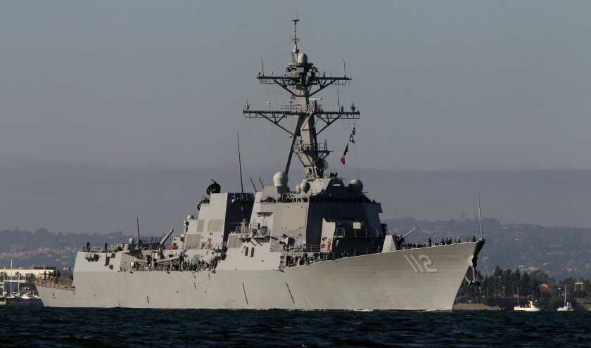 The Navy destroyer Michael Murphy cruises through San Diego Bay. The ship's namesake was honored for his actions in combat in Afghanistan.