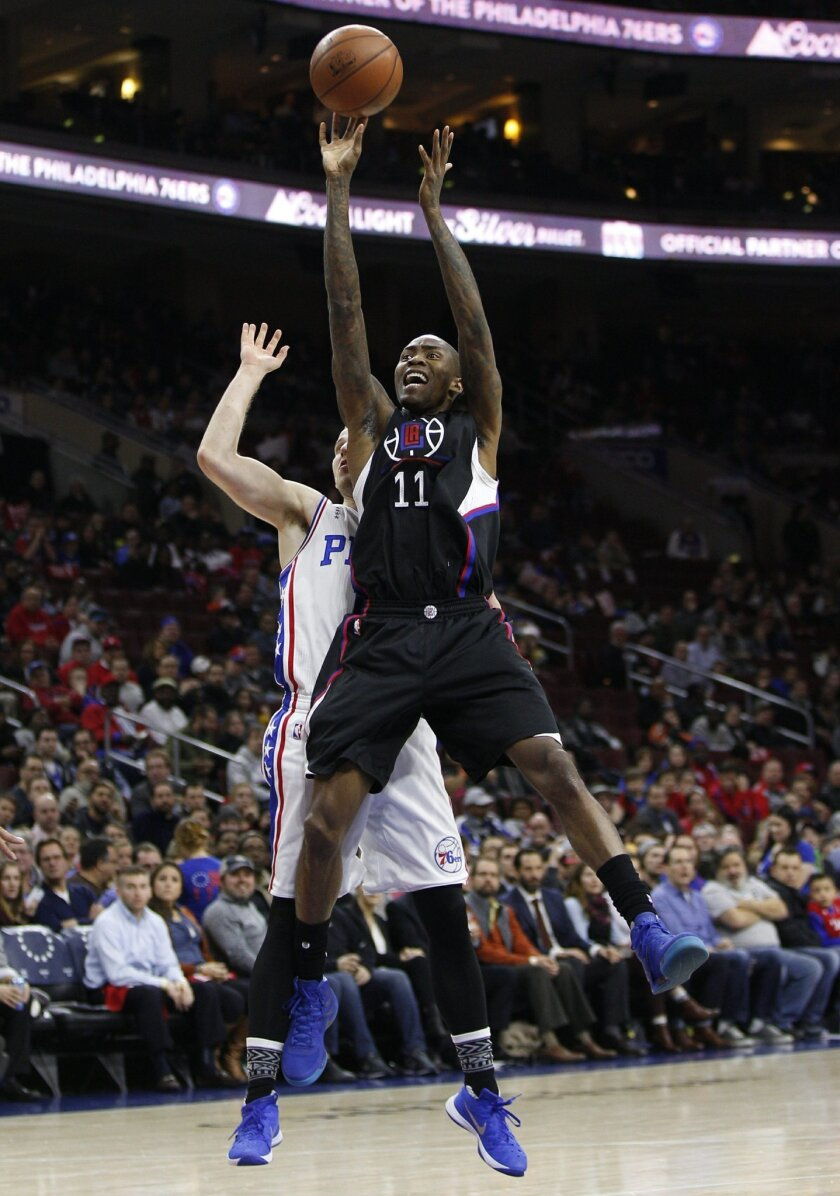 Los Angeles Clippers' Jamal Crawford (11) shoots while being fouled by Philadelphia 76ers' Nik Stauskas (11) during the first half of an NBA basketball game, Monday, Feb. 8, 2016, in Philadelphia. (AP Photo/Chris Szagola)