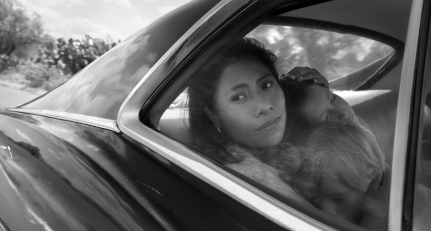 """This image released by Netflix shows Yalitza Aparicio in a scene from the film """"Roma,"""" by filmmaker"""