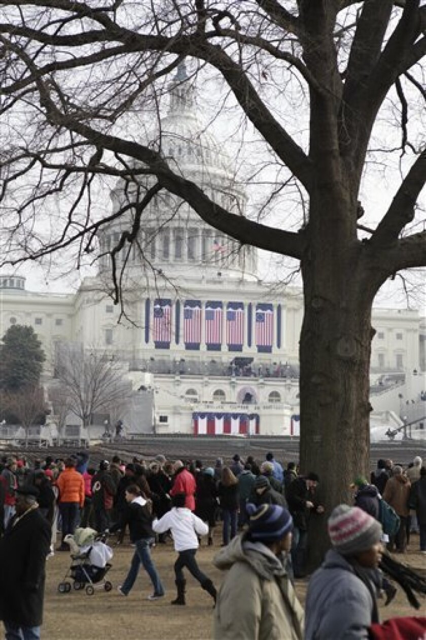 People crowd in front of the West front of the Capitol in Washington Monday, Jan. 19, 2009, before the swearing-in of President-elect Barack Obama Tuesday.  (AP Photo/Alex Brandon)