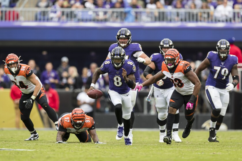 Baltimore Ravens quarterback Lamar Jackson scrambles against the Bengals on Sunday.