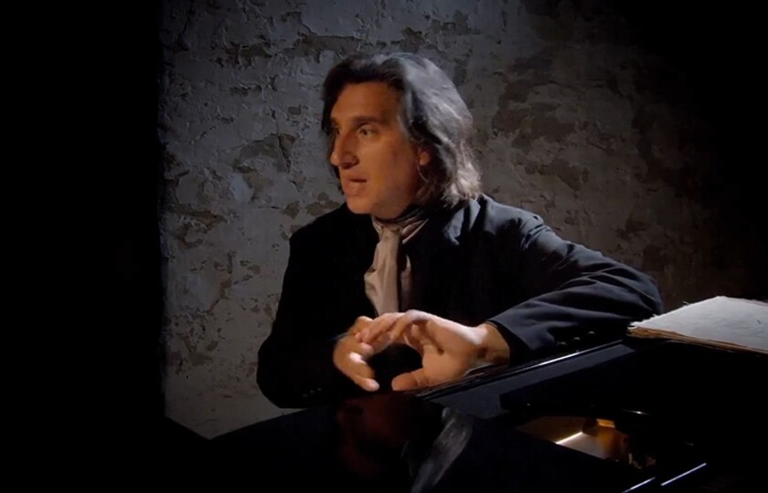 """A scene at the piano from """"Hershey Felder: Beethoven, a Play with Music."""""""