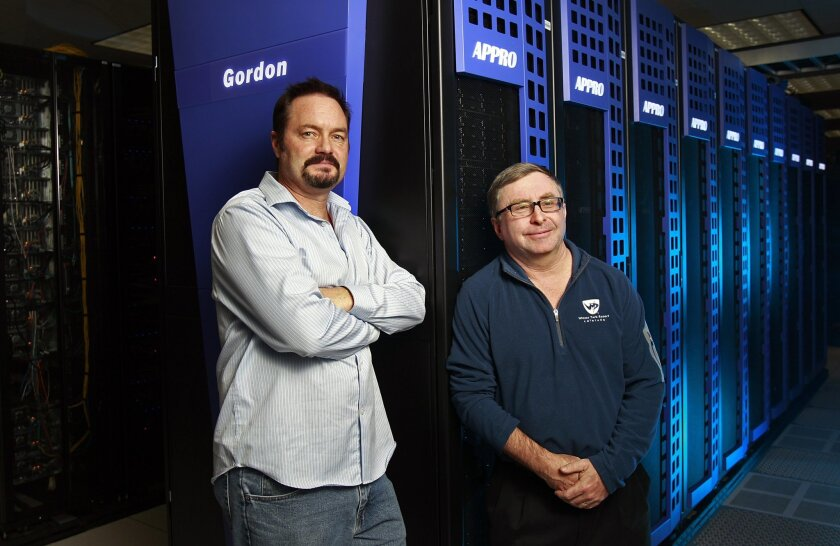 Mike Norman, right, director of the San Diego Supercomputer Center at UCSD, along with assistant director Allan Snavely look  at Gordon, one of the most powerful computers in southern California on Thursday, Dec. 8, 2011.