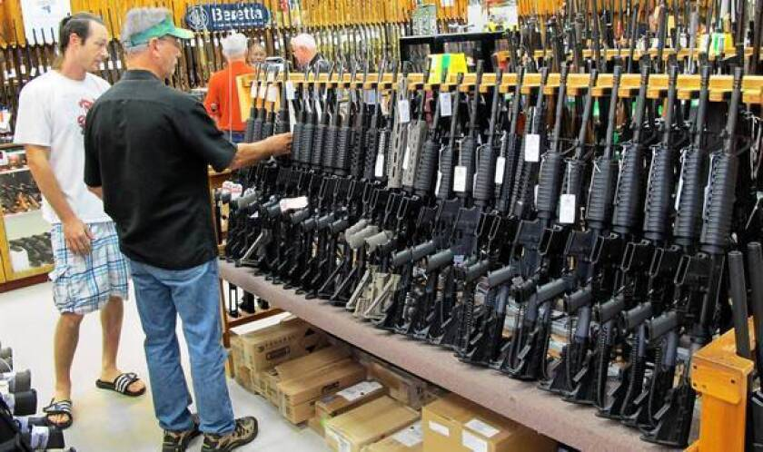 Customers shop for guns at Jim's Pawn Shop in Fayetteville, N.C., where many businesses feared sales would be hurt by the government shutdown.