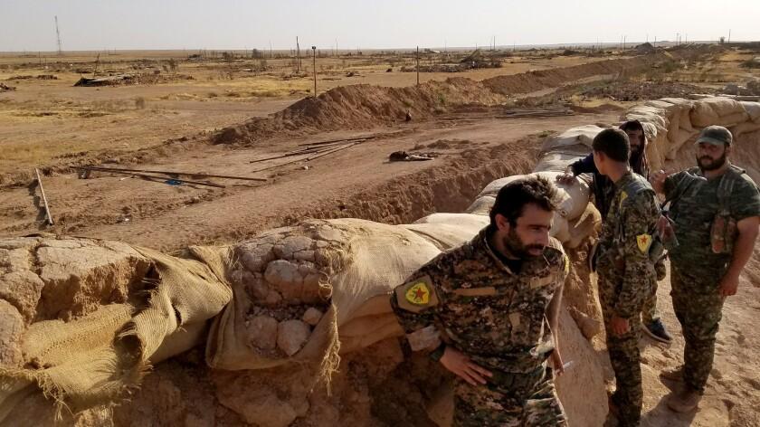 Commander Dilsoz Derek, 32, visits U.S.-backed People's Protection Unit (YPG) troops stationed at ba