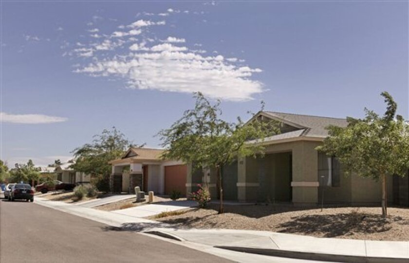 Some new homes, developed by the Association of Community Organizations for Reform Now (ACORN) Housing Corp., are seen in the Beverly subdivision of Phoenix, Ariz., Wednesday, Sept. 30, 2009. In the wake ACORN's recent troubles, which range from voter fraud charges to embarrassing videos of its employees, three Republican congressmen have asked 14 banks to provide details on their dealings with ACORN, reviving a longstanding GOP fight against the 1977 Community Reinvestment Act on bank investment in poor areas. (AP Photo/Ross D. Franklin)