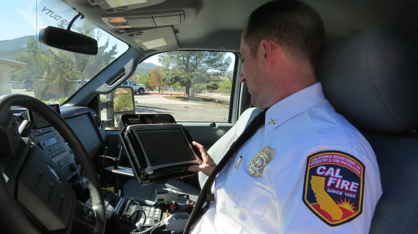Cal Fire Battalion Chief Chris Amestoy with recently installed computer and communication system.