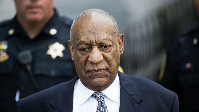 Bill Cosby leaves Montgomery County Courthouse after a hearing in his sexual assault case in Norristown, Pa., on Aug. 22, 2017.