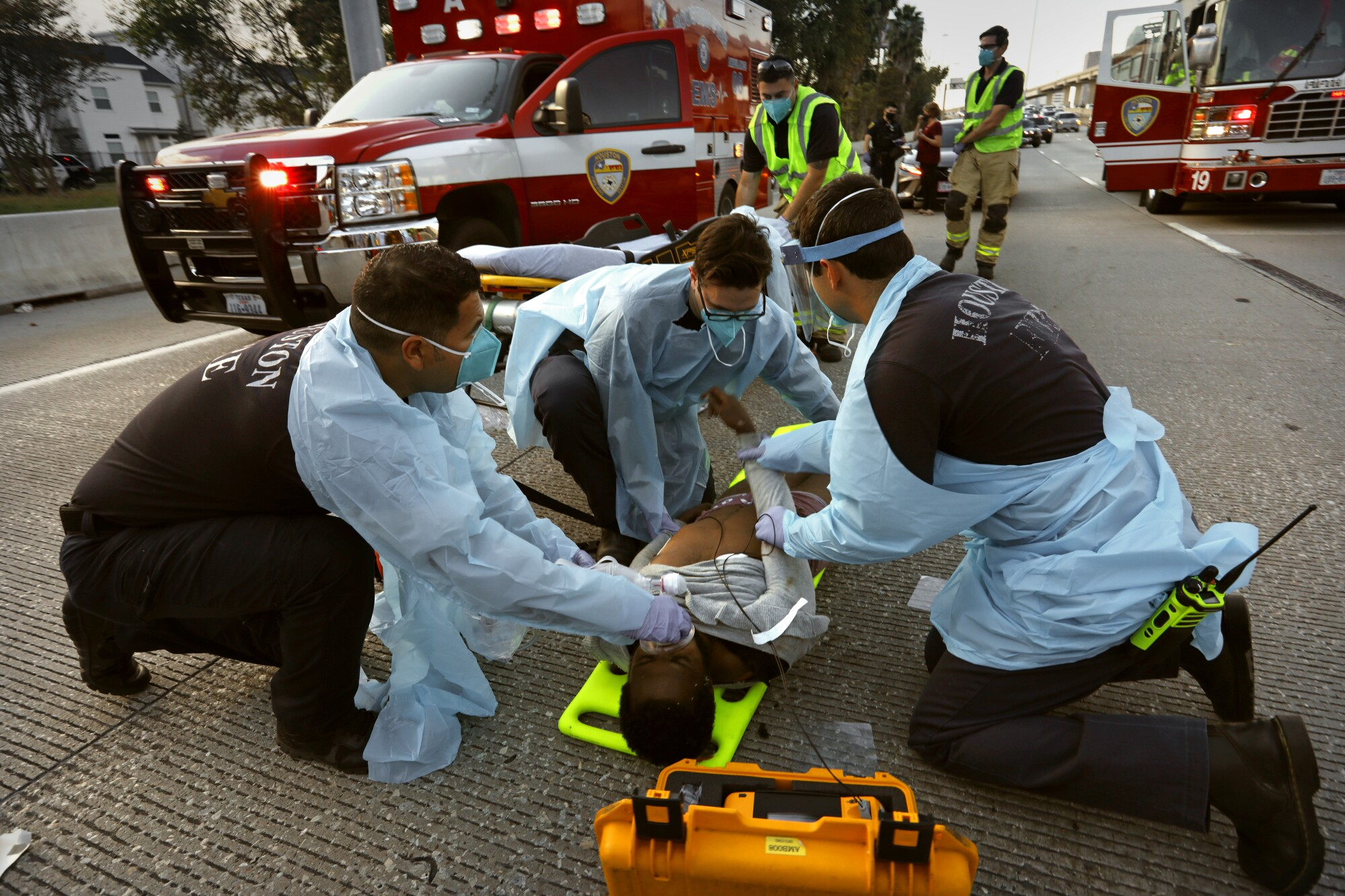 Fire Capt. Daniel Soto, center, supervises as firefighters treat a man struck by a car Nov. 22 in Houston.