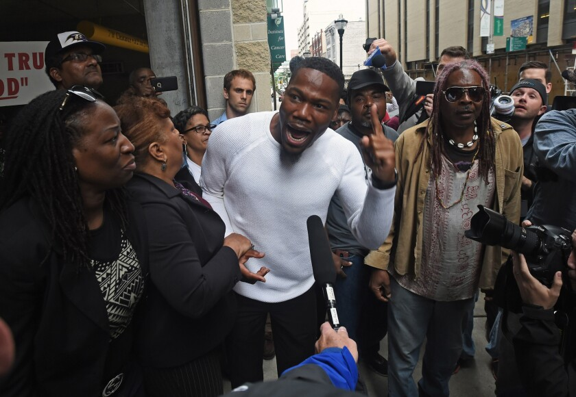 Activist and pastor Westley West, center, on May 23 in Baltimore, after Baltimore City police officer Edward Nero was found not guilty of all charges relating to the death of Freddie Gray last year.