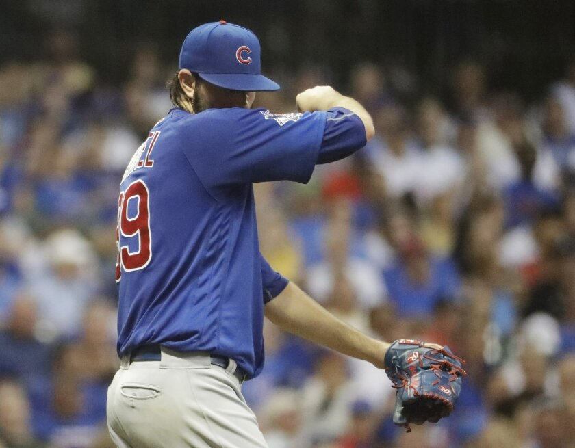 Chicago Cubs starting pitcher Jason Hammel wipes his face during the first inning of a baseball game against the Milwaukee Brewers Tuesday, Sept. 6, 2016, in Milwaukee. The Brewers scored five runs in the inning. (AP Photo/Morry Gash)