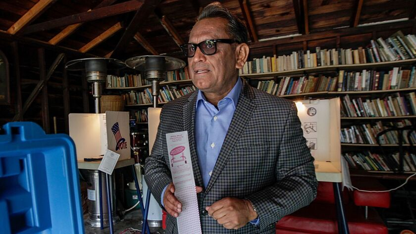 City Councilman Gil Cedillo casts his vote at a polling station in a residence on Edgeware Road in Los Angeles on May 16.