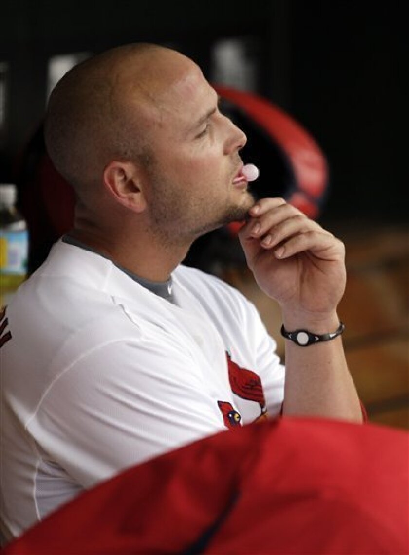 St. Louis Cardinals' Matt Holliday sits on the bench after being picked off at second base during the sixth inning of a baseball game against the San Diego Padres on opening day Thursday, March 31, 2011, in St. Louis. (AP Photo/Tom Gannam)