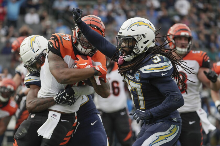 Chargers safety Jahleel Addae celebrates as Cincinnati Bengals running back Joe Mixon is stopped short of a first down.