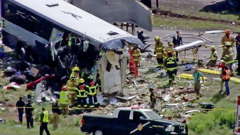 This photo from video provided by KQRENews13 shows first responders working the scene of a collision