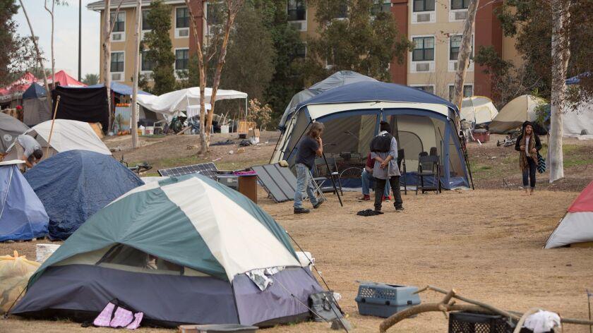 A homeless encampment along the Santa Ana River Trail in Anaheim on Wednesday, Nov. 29. Homeless Pe