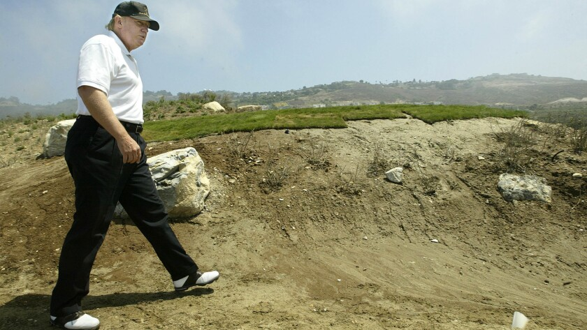 Donald Trump walks down an unfinished pathway leading to the 17th tee at Trump National Golf Club, Los Angeles in Rancho Palos Verdes in 2005