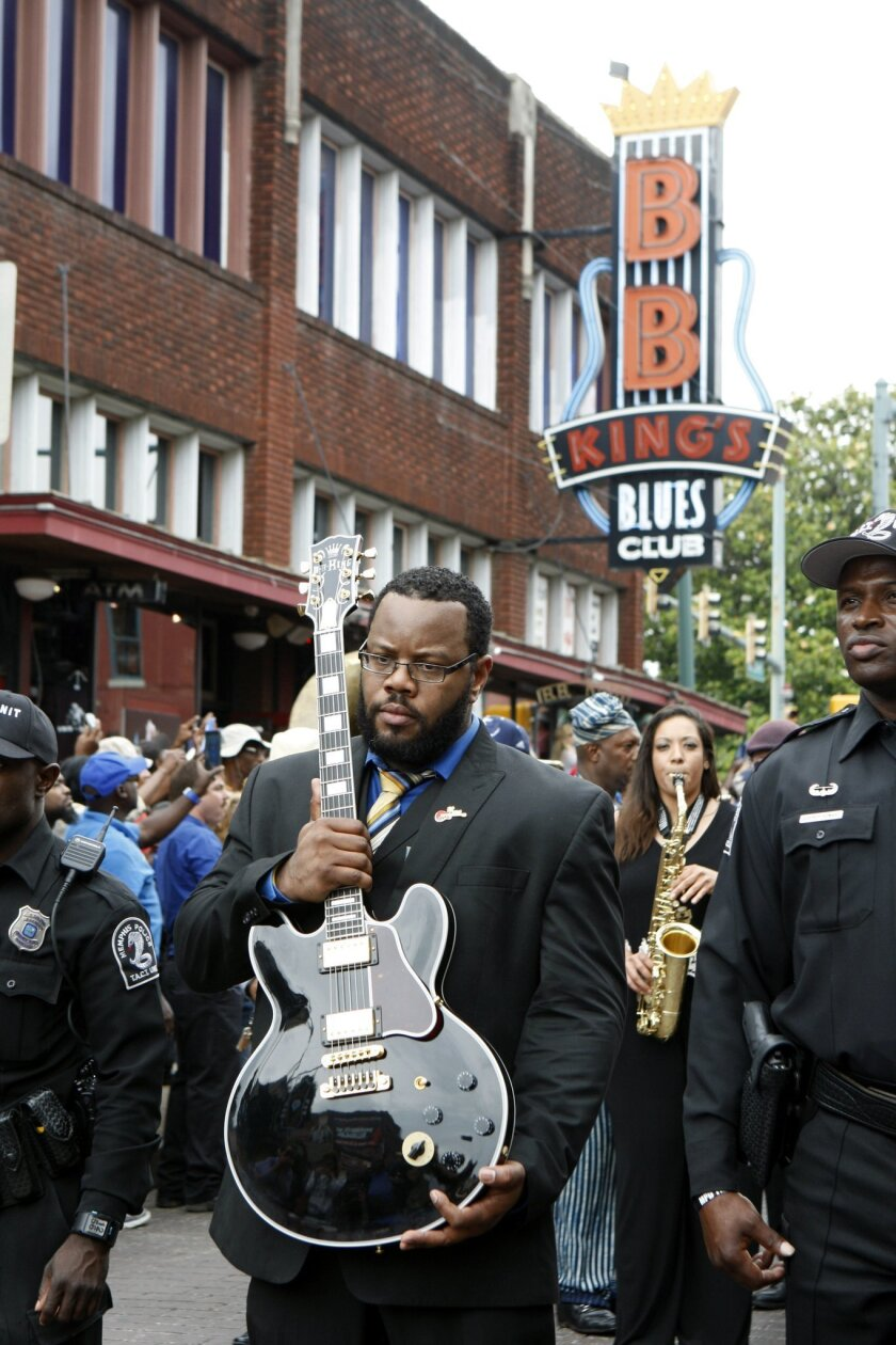 The guitar of blues musician B.B. King is taken down Beale Street during a procession in honor of King, Wednesday, May 27, 2015, in Memphis, Tenn. The city of Memphis is saying farewell to blues legend B.B. King with a tribute and processional down Beale Street on Wednesday. King, who was given the nickname Beale Street Blues Boy, died May 14 in Las Vegas. He was 89. (AP Photo/Karen Pulfer Focht)