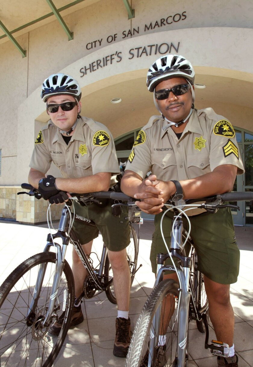 Deputy Dustin Nelson, left, and Sgt. Mark Haynesworth, are members of the newly revitalized bike patrol team at the San Marcos sheriff's station.