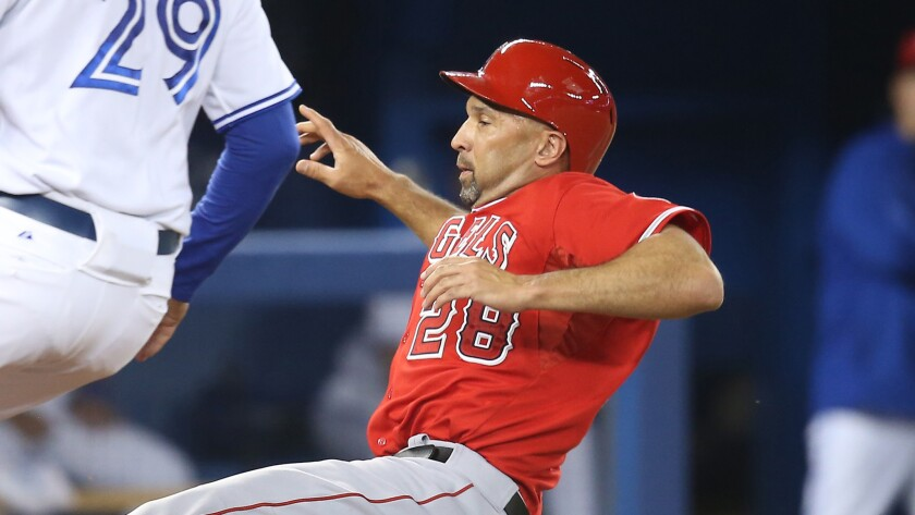Angels designated hitter Raul Ibanez slides into home plate during Friday's win over the Toronto Blue Jays.