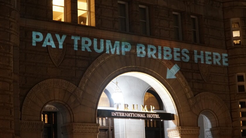 Artist Robin Bell projected messages of protest onto the Trump International Hotel in Washington, D.