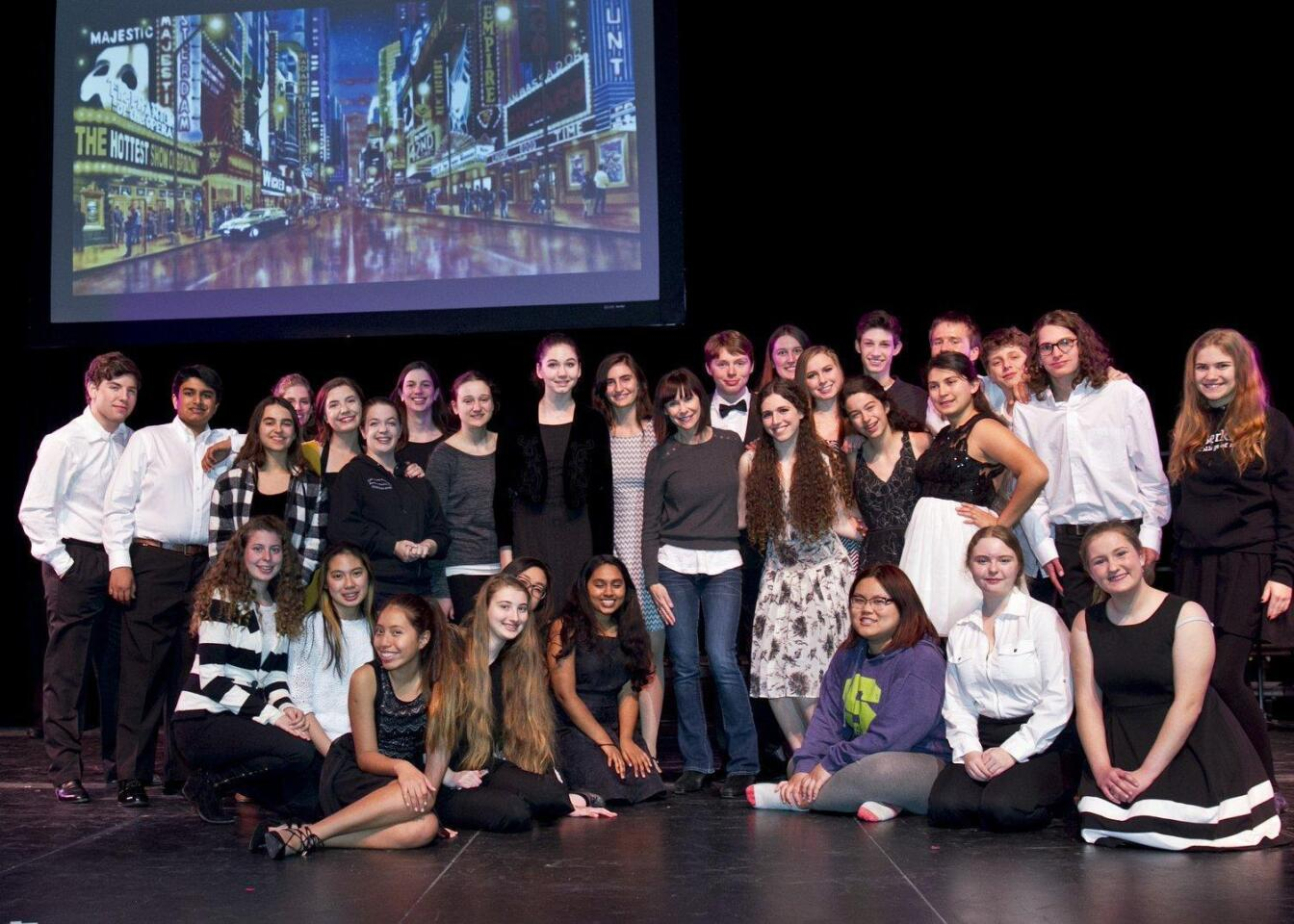 Guest artist Susan Egan (standing center front) with student performers