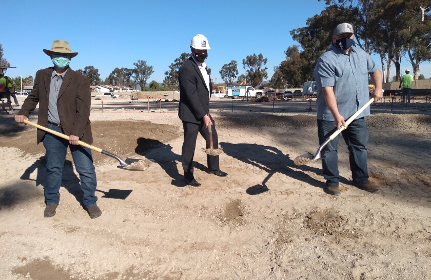 ALDI Director of Real Estate Skip Janes, center, breaks ground on a Ramona ALDI with Rob Lewallen  and Casey Lynch.