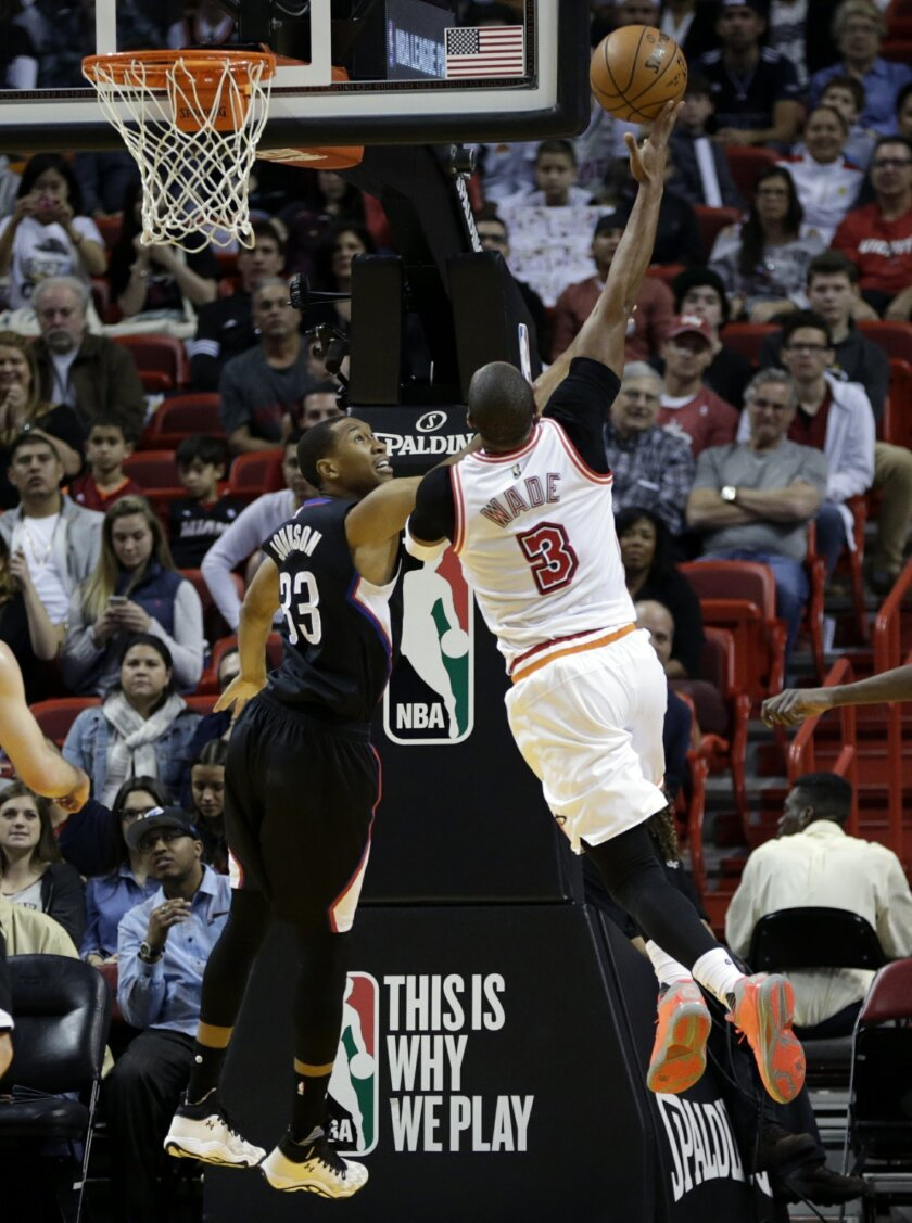 Miami Heat guard Dwyane Wade (3) shoots over Los Angeles Clippers forward Wesley Johnson (33) during the first half of an NBA basketball game, Sunday, Feb. 7, 2016, in Miami. (AP Photo/Lynne Sladky)