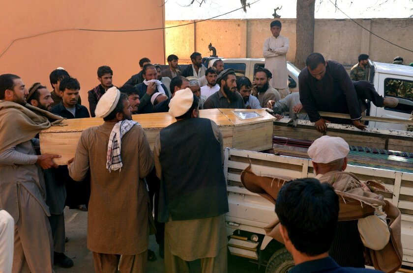 Afghan men carry the coffin of a victim of a deadly suicide attack in Kunar province, east of Kabul, Afghanistan, Saturday, Feb. 27, 2016. At least 10 civilians were killed Saturday morning when a suicide bomber on a motorcycle targeted on a local tribal leader near a park, an Afghan official said. The tribal leader Khan Jan was among those killed. (AP Photos/Mohammad Anwar Danishyar)