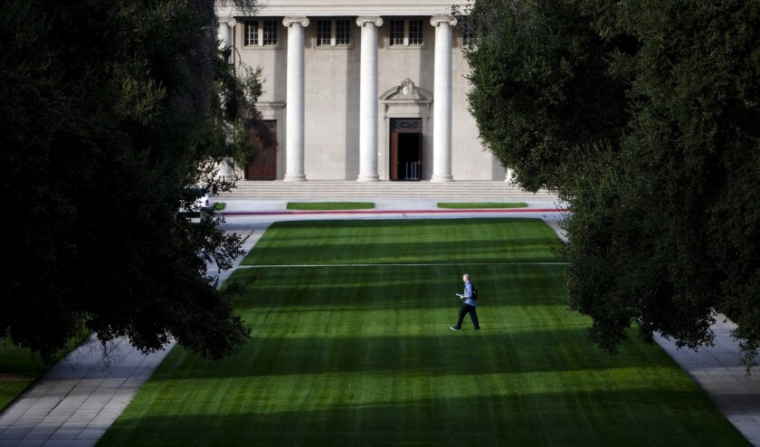A student walks across the mall at the University of Redlands in November of 2011.