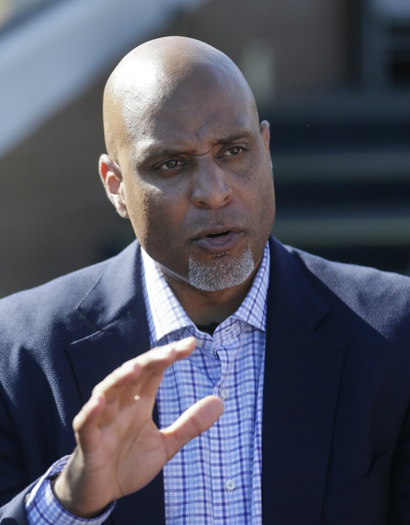 FILE - In this March 17, 2015, file photo, Major League Baseball Players Association executive and former Detroit Tigers first baseman Tony Clark talks to the media before a spring training exhibition baseball game between the Tigers and the Washington Nationals in Lakeland, Fla. With spring traini