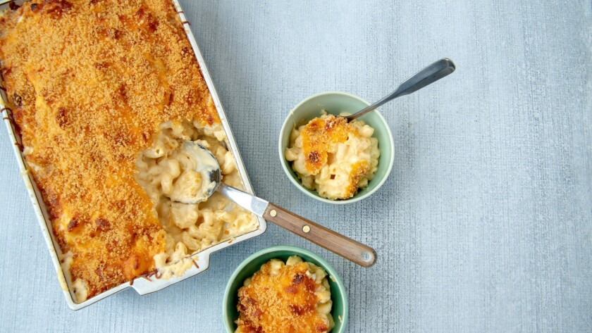 Cheesy, comforting baked mac 'n' cheese is a great dish to make and freeze for dinners later in the week. Prop styling by Nidia Cueva.