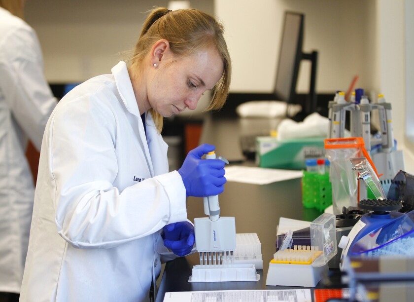 A clinical laboratory scientist prepares patient samples for sequencing at Rady Children's Institute for Genomic Medicine.