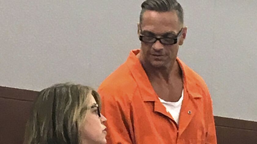 Nevada death row inmate Scott Dozier with Lori Teicher, a federal public defender, in 2017.