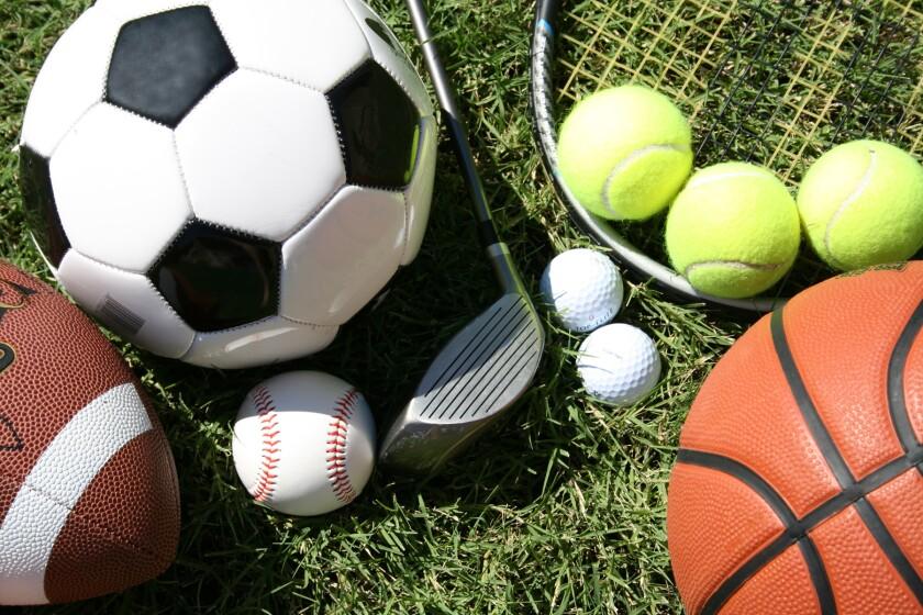 various sports equipment football, soccer ball, tennis balls, etc.