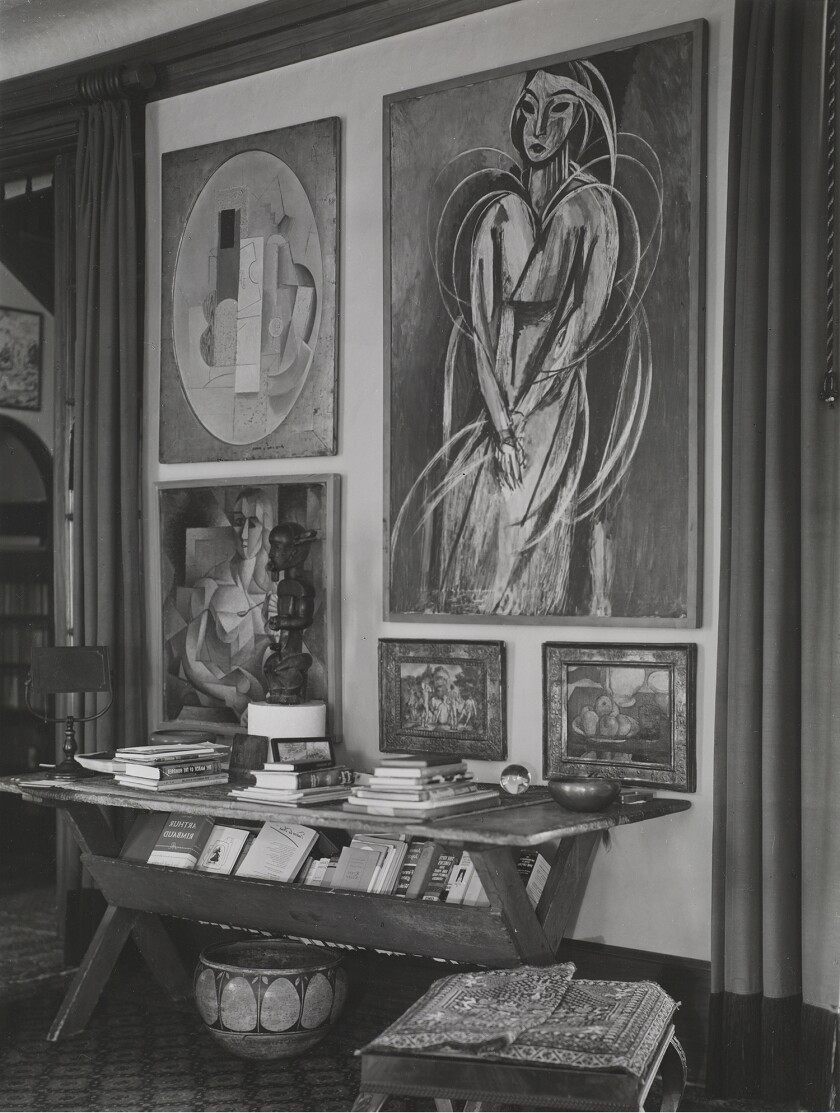 A 1912 Picasso Cubist still life hangs next to a 1913-14 Matisse portrait in the Arensbergs' living room.