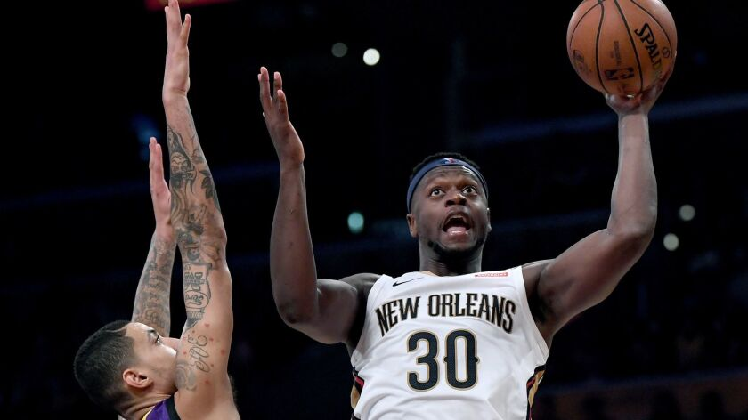 Julius Randle of the New Orleans Pelicans scores in front of Kyle Kuzma of the Lakers during the first half Friday.