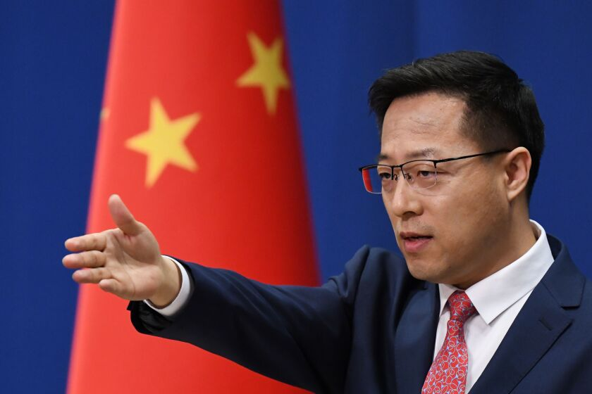 Chinese Foreign Ministry spokesman Zhao Lijian takes a question at the daily media briefing in Beijing on April 8.