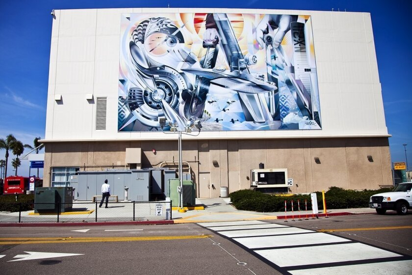 New aviation-themed mural on east facade of San Diego International Airport's commuter terminal by artist Jari WERC Alvarez replaces the painting of Charles Lindbergh holding a model of his plane.