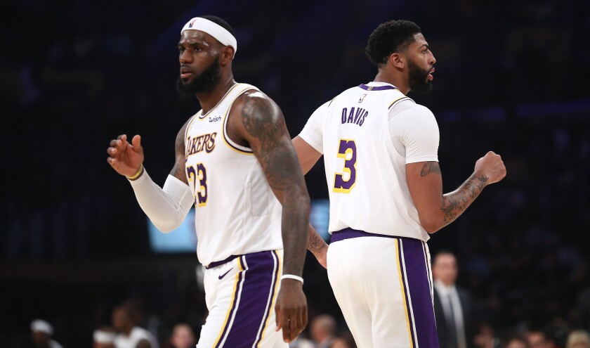 Lakers stars LeBron James and Anthony Davis play in a preseason game against the Golden State Warriors on Oct. 16.