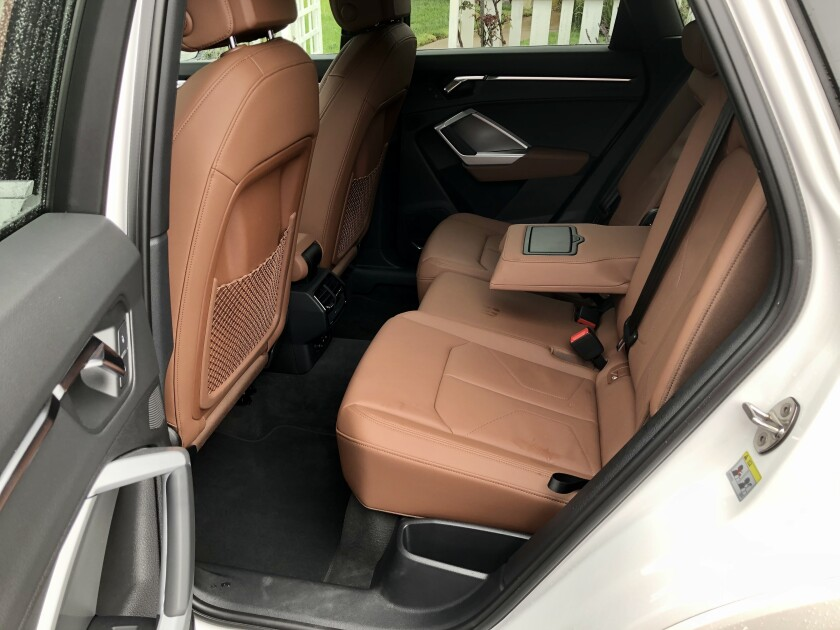 The tall AWD tunnel makes the Q3 a great four-seater, with reclining seatbacks and extended thigh support at the window seats.