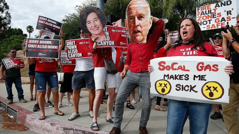 PORTER RANCH, CA-JULY 24, 2017: Andrea Leon-Grossman, right, is joined by other protesters at the