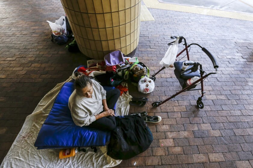 Denise Aken, 58, who has been homeless for 19 months, rests under the roof at the Courtyard, a downtown Santa Ana bus terminal that recently opened its doors to the hundreds of homeless living at the Civic Center.