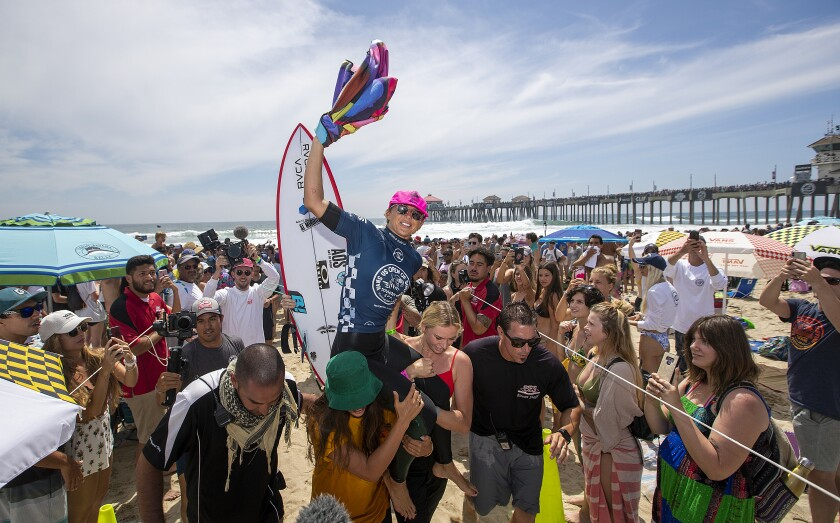 Sage Erickson celebrates winning the women's championship at the 2019 U.S. Open of Surfing in Huntington Beach on Sunday.