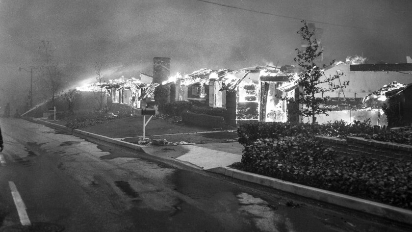 Nov. 6, 1961: Homes on Roscomare Road in Bel-Air burn during the brush fire.