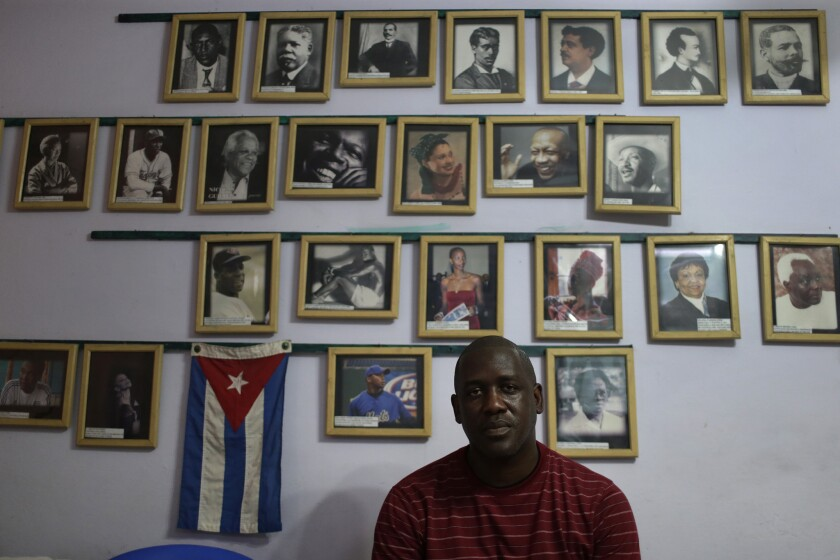 Juan Madrazo Luna displays a gallery of famous Afro-Cubans in his Havana home.