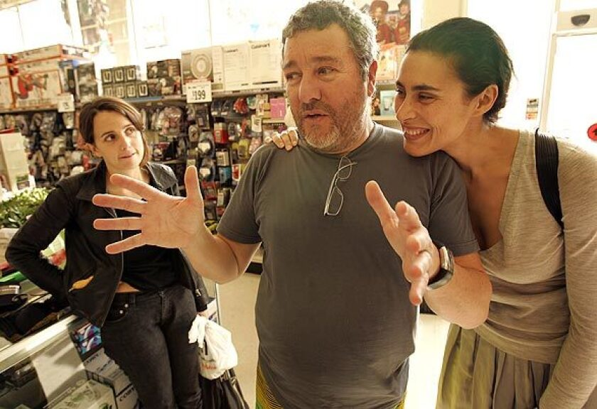 "Famed designer Philippe Starck, his wife, Jasmine, right, and daughter Ara go shopping at a Big Lots store in Hollywood to show how far a dollar can go in recessionary times. ""In a time of financial crisis, we must go back to timeless objects and rediscover the elegance of basics,"" says Starck, the designer behind L.A. hot spots such as the restaurant Katsuya. ""Can you live elegantly and economically? We shall see. Give me 20 minutes,"" says the designer of furniture, accessories and other products."