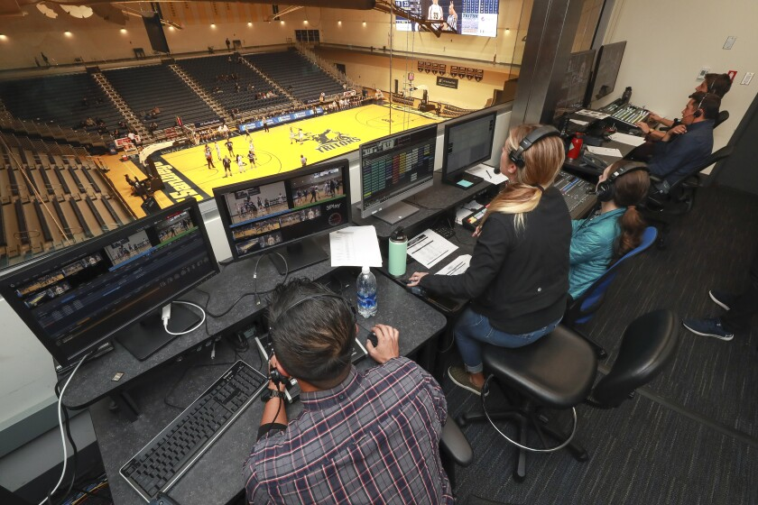 Members of the UCSD video production crew work in the UC San Diego broadcast production control room while the women's basketball team played against Cal State Monterey Bay at the RIMAC Arena on Thursday, January 2, 2020 in San Diego, California.