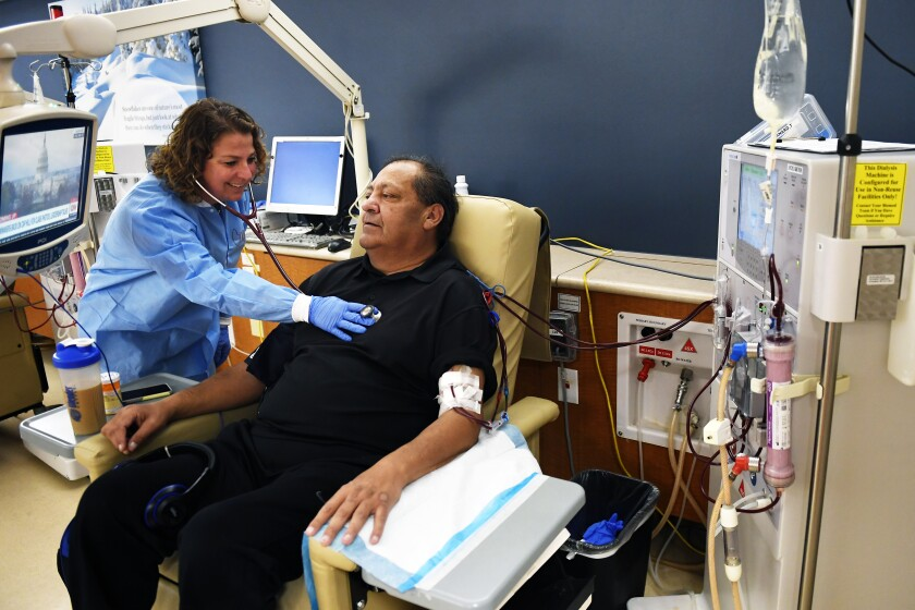 Corinna Montesano, a registered nurse, checks Bernard Trujillo's heartbeat at DaVita Lakewood Dialysis Center in Colorado last year.