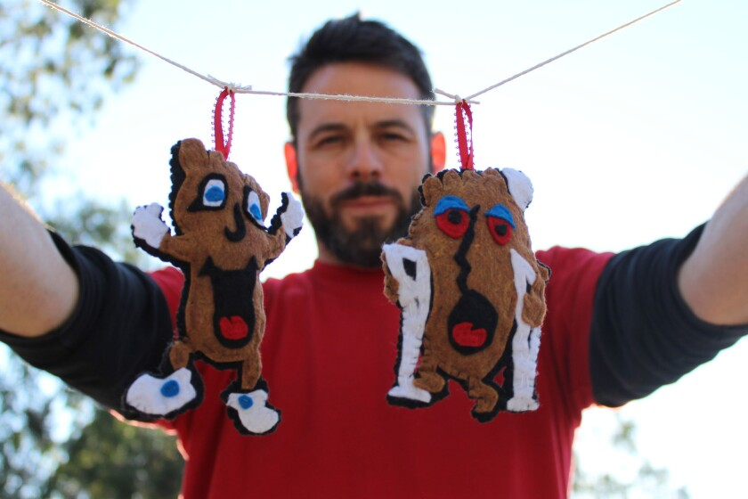 The artist Billy Kheel with his handcrafted HappyFoot and Sad Foot ornaments, $25, based on the character on a podiatry clinic sign on Sunset Boulevard.